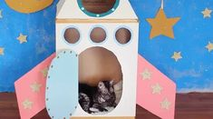 How To Make A Cardboard Rocket Ship For Your Cat Using Old Boxes | Cuteness Cardboard Rocket, Cardboard Box Diy, Cardboard Cat House, Cardboard Castle, Cat Crafts, Crafts For Kids, Buzz Lightyear Wings, Cat Castle, Cat House Diy