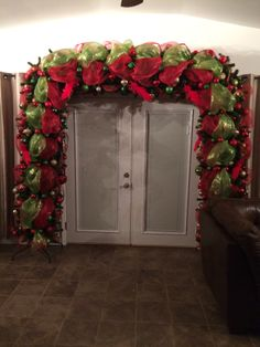 French doorway arch in traditional red and green mesh and ornaments  (Smith-Lambert) 2013