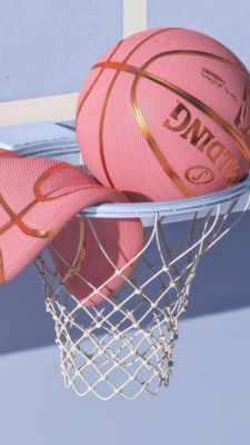 💗Pink basketball in the hoop with a flat one on a sunny day💗