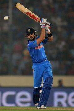 ICC world Cup 2014 20-20 Virat Kohli of India hits the ball towards the boundary.
