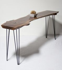 Live edge console table for behind couch with leather storage ottomans under as seating