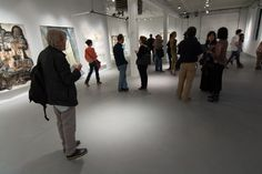 Visitors to PROTO Gallery attending the PAPER GIANTS opening reception