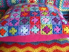 "A crochet cushion cover with a repurposed knitted jumper for the back... Described as ""wooley-buttony-goodness"". Love it."