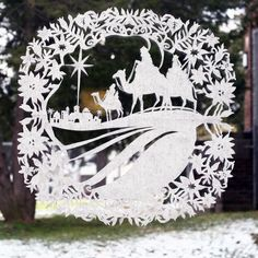 Christmas window cuttings, about 16 inches in diameter. German paper cutting. Scherenschnitte.