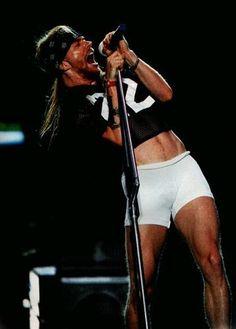 Axl Rose, Guns N' Roses, Use Your Illusion World Tour, early Axl Rose, Guns N Roses, John Mayer, Mini Shorts, White Shorts, Rango Vocal, Rock N Roll, Sweet Child O' Mine, Duff Mckagan