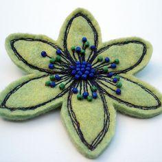 @: felt brooch...machine stitching with beads hand sewn on...<3