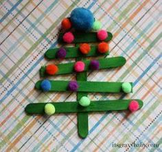 Popsicle Stick Pom Pom Christmas Trees- quick and easy Christmas craft idea for kids! Could be great for the classroom, too!