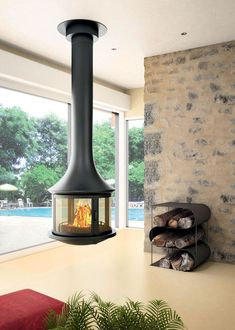 Handmade in the South of France, the Bordelet Lea 998 suspended fireplace is a central hanging wood fire with a playful 360 viewing area of the flames. Suspended Fireplace, Hanging Fireplace, Wood Fireplace, Fireplace Design, Fireplaces Uk, Log Burner, Hearth, Interior Styling, Industrial