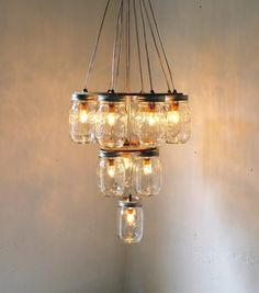 Turn mason jars into a chandelier worthy of a grand ballroom.or for a simple entryway. Get your mason jars at The ReUstore! Mason Jar Chandelier, Mason Jar Lighting, Diy Chandelier, Kitchen Lighting, Kitchen Chandelier, Chandelier Wedding, Patio Lighting, Bottle Chandelier, Chandelier Video