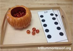Counting pumpkins using number cards
