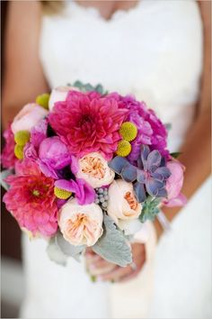 vibrant pink and purple bridal bouquet #bouquet #bride #weddingchicks http://www.weddingchicks.com/2014/02/04/country-fair-wedding/