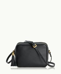 Compact size and go-to ease make this bag an everyday essential, in classic colors for a timeless wardrobe addition.