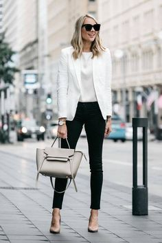 White blazer with white silk blouse, black ankle skinny trousers, taupe purse | modern chic city girl work outfit