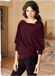 A portrait of modern glamour, our top features an elegant, figure-flattering drape. Full-fashion knit of fine gauge pima (60%) and bamboo (40%), with an angular slit neckline and wide rib trim at the 3⁄4-sleeves and hem for an easy, blouson shape; in Bordeaux or Black.