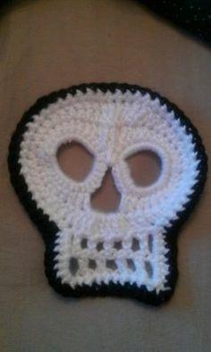Crochet skull with black border... link to skull pattern... I added the border http://www.ravelry.com/patterns/library/day-of-the-dead-crochet-skull