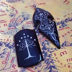 This Gil-Galad Shield Pendant and Gondor Pendant are hand carved by artist Darrel Morris from water buffalo horn and include scrimshaw details (if you want to learn more about scrimshaw, click here). Both are available for purchase through his website, so start saving your pennies now!