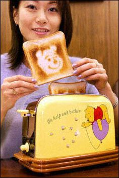 Disney, Winnie the Pooh toaster picture. A specialized kitchen appliance that burns bread in the shape of the famous bear in this unusual product photo.