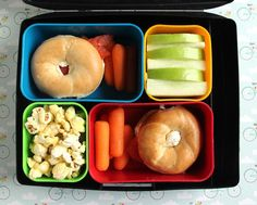 Lox and cream cheese bagels; carrots; apple slices; popcorn.