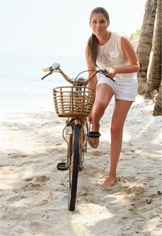Aerin Lauder at the beach with a wicker bike