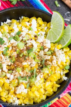 Skillet Mexican Street Corn Recipe is corn off the cobb served Mexican style it's smothered with a creamy spread and topped with feta cheese, cilantro, and green onions.
