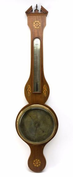 A 19th century mahogany wheel barometer engraved N Ortelli & Co.