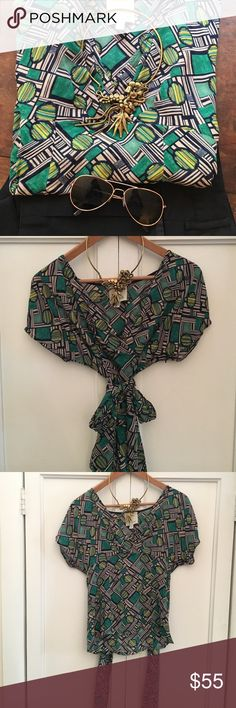 Anthropologie Odille tie waist top A gorgeous top from Anthropologie with an amazing print that ties at the waist for a gorgeous shape. Size is 0 but zips at the side so would fit a size 2 as well. Anthropologie Tops Blouses