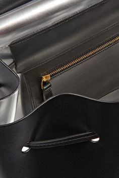 Black leather (Cow) Drawstring top Designer color: Black/ Silver Comes with dust bag
