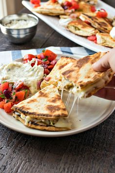 Greek Chicken Quesadillas - Chewy flatbread covered in mozzarella and feta cheese and Greek-marinated chicken and grilled to perfection. Served with a tomato salad and homemade tzatziki sauce. Greek Chicken Pita, Greek Marinated Chicken, Chicken Gyros, Chicken Quesadillas, Feta Cheese Pizza, Pesto Grilled Cheeses, Greek Recipes, Meat Recipes, Cooking Recipes