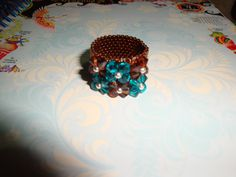 Swarovski ring turquoise and brown anillo handmade By: @chiiica_ via: http://chicadecrystal.blogspot.com/2011/05/ring-with-six-little-flowers.html