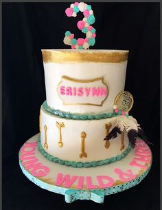 BOHO cake! Young Wild & Three. Edible dream catcher, arrows, turquoise and flowers.