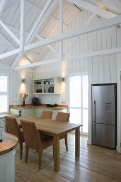 White-painted vaulted ceilings in traditional kitchen in Tin House in Dartmoor National Park
