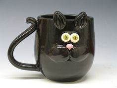 Handmade Kitty Cat Mugs. OMG! So cute! Adorable kitty cat faces with big fun eyes. Thrown on a potters wheel, hand altered, with handmade design.