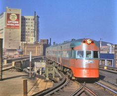The North Shore Electroliner train (which ran from Chicago to Milwaukee daily) approaching the Wilson L station, c.1941. The tall building o...