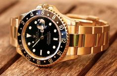 a beautiful Rolex GMT II in yellow gold