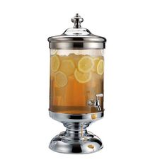 Serve sweet sangria or tart lemonade in chic style with this glass beverage dispenser, featuring a pedestal base and finial lid.    Prod...