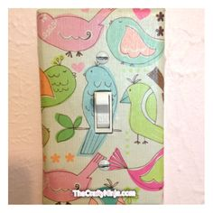 Scrapbook paper + modge podge = creative lightswitch cover! :)