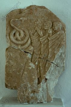 Greek, 4th century BC.  Votive relief to the Chthonic Hermes.  Relief. Found: Samos.