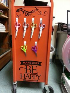The other side of the Makerspace mobile cart. Here we have scissors with different blades all hung on hooks.: