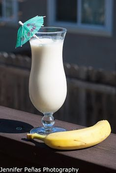 Banana Cream Colada (2 oz coconut rum 1 small banana 1/2 oz banana liqueur 1 1/2 oz pineapple juice 1 oz cream of coconut 1/2 cup vanilla ice cream)