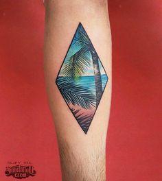 Beach landscape rhombus tattoo on the left inner forearm.                                                                                                                                                                                 More