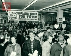 Early Christmas shopping rush at The Mart, 650 Main Street, November 11, 1957, Worcester Massachusetts. Photograph by George Cocaine.