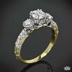 I love that this is yellow gold with the little diamonds down the side! Just add a 1.5 carat center stone and it's perfect!! lol, a girl can dream right?