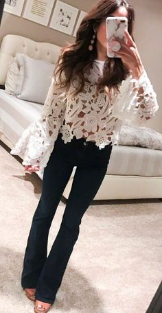 #spring #outfits woman in white long-sleeved blouse and black pants. Pic by @alexis.belbel