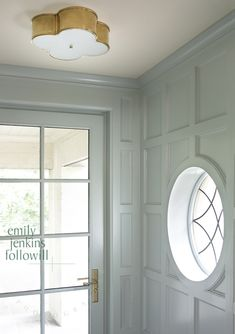 Great grid paneling & window & light fixture