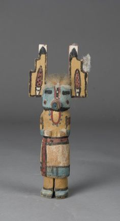 """Doll with large serated ears and applied feathers. Original paint, purchased in Arizona in the 1950's. 8.75"""" H. Private collection Hadley Twp., Michigan."""