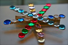 Popsicle stick ornaments, ornametns, glue, rhinestones