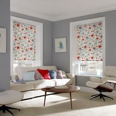 Gorgeous Grey Pale grey has become a popular colour choice for walls over the last few years, and for good reason. Here, when combined with soft creams, pale blues, pops of red and pretty floral blinds, it creates a cosy, calming but contemporary living room.