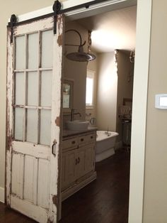 Old door re-purposed with Barn Door Sliding Fixture, for Bathroom Door (painted panes?)