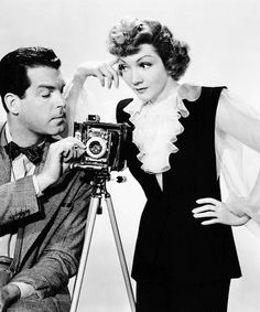 """FRED MacMurray and Claudette Colbert in 1943's """"No Time For Love."""" Colbert is a photographer for a magazine who hooks up with blue collar Fred."""