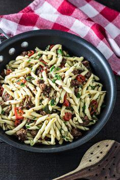 Strozzapreti Pasta with Lamb Sausage, Chilies & Olives · My Three Seasons